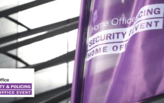 Flag and logo outside Security and Policing